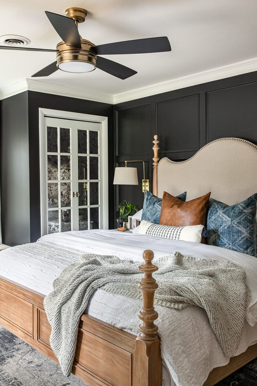 moody modern vintage master bedroom with black paint