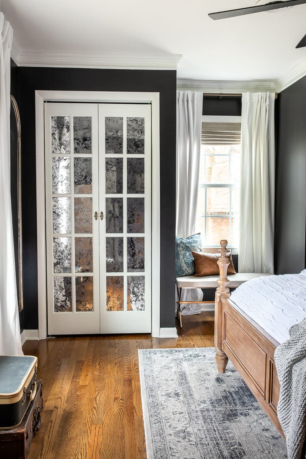 black master bedroom with French bifold closet doors