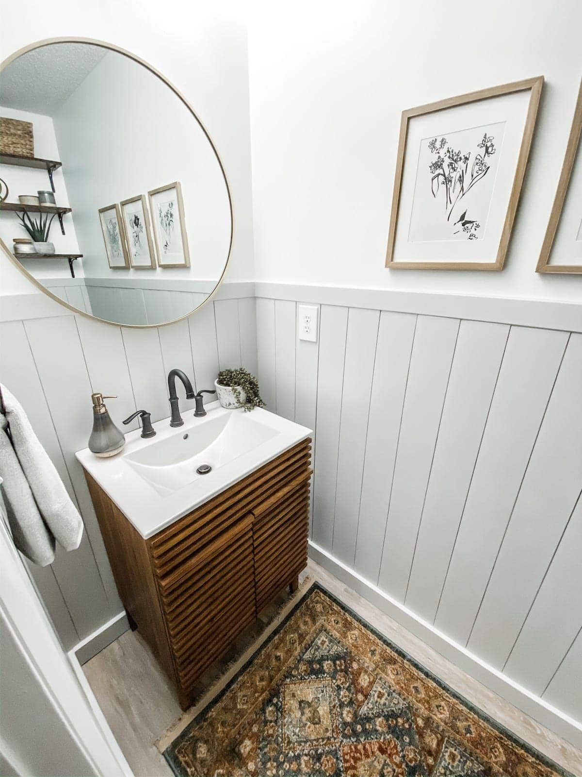 powder room with gray vertical shiplap and white walls