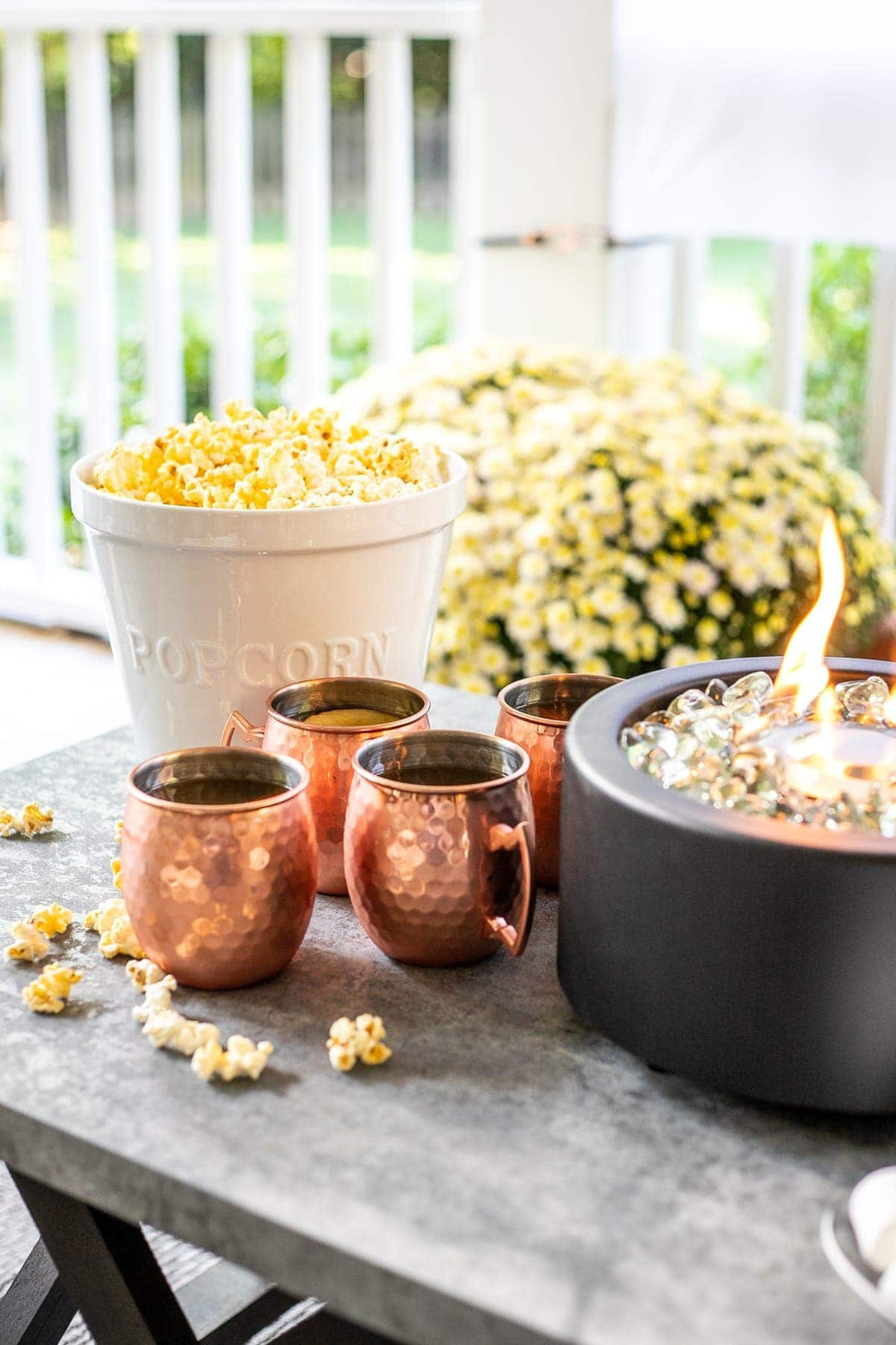 Copper mugs, popcorn, and fire bowl