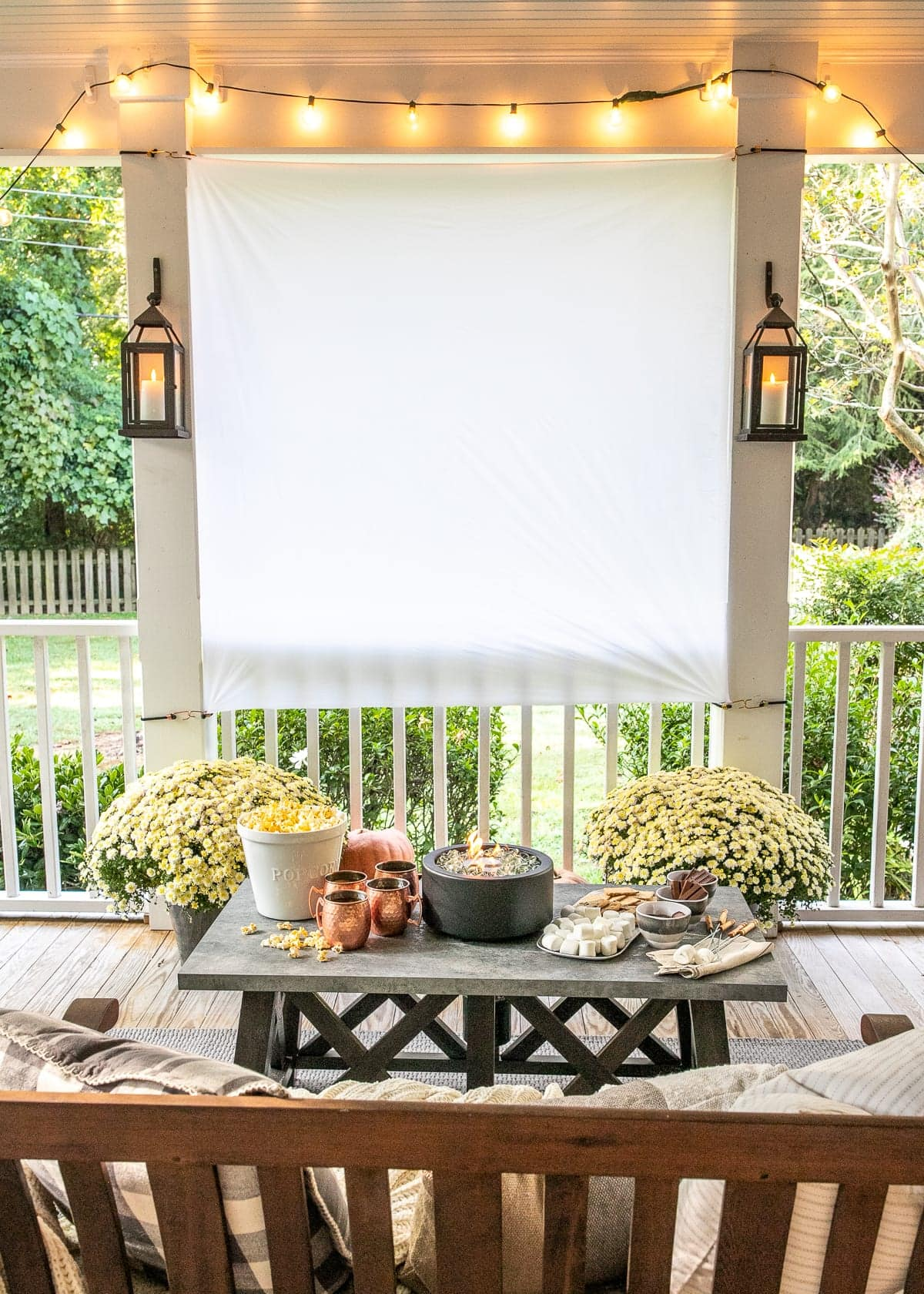 DIY Outdoor Movie Screen and DIY S'mores Table on Fall Back Porch