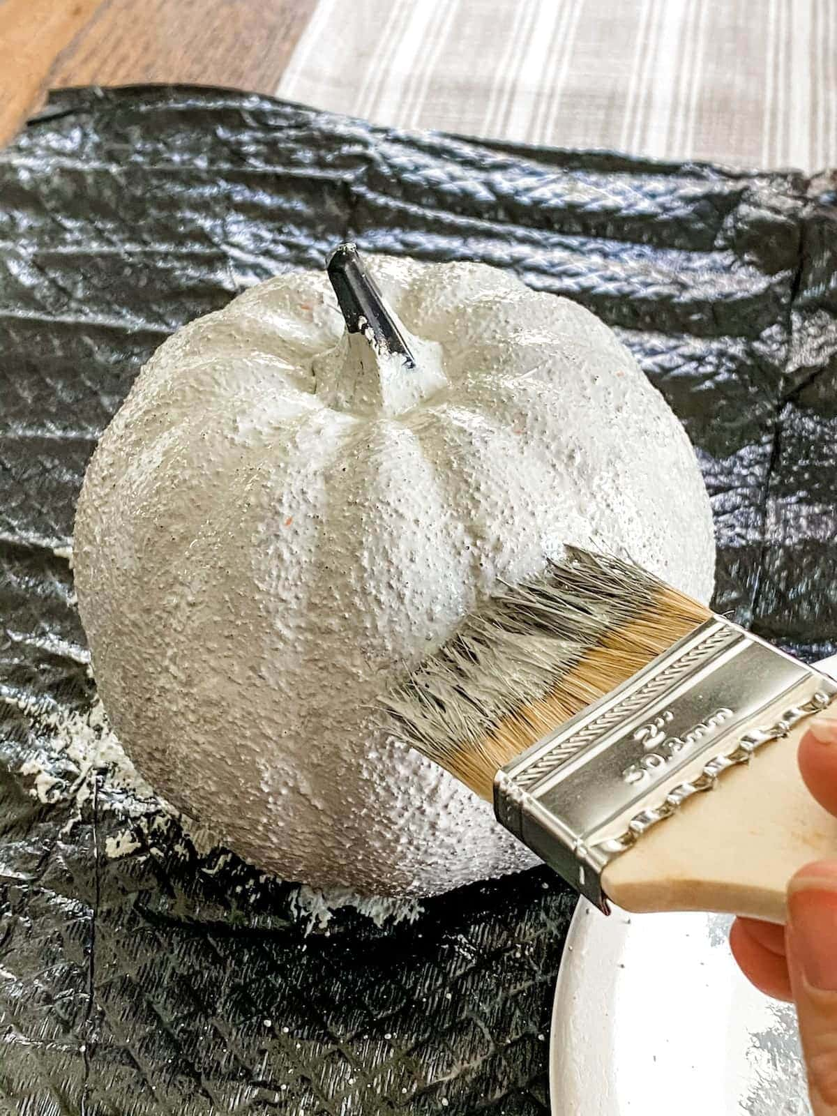 fake pumpkin with concrete paint