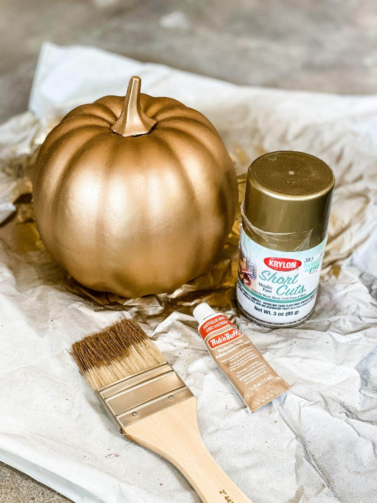 fake pumpkin painted to look like aged brass