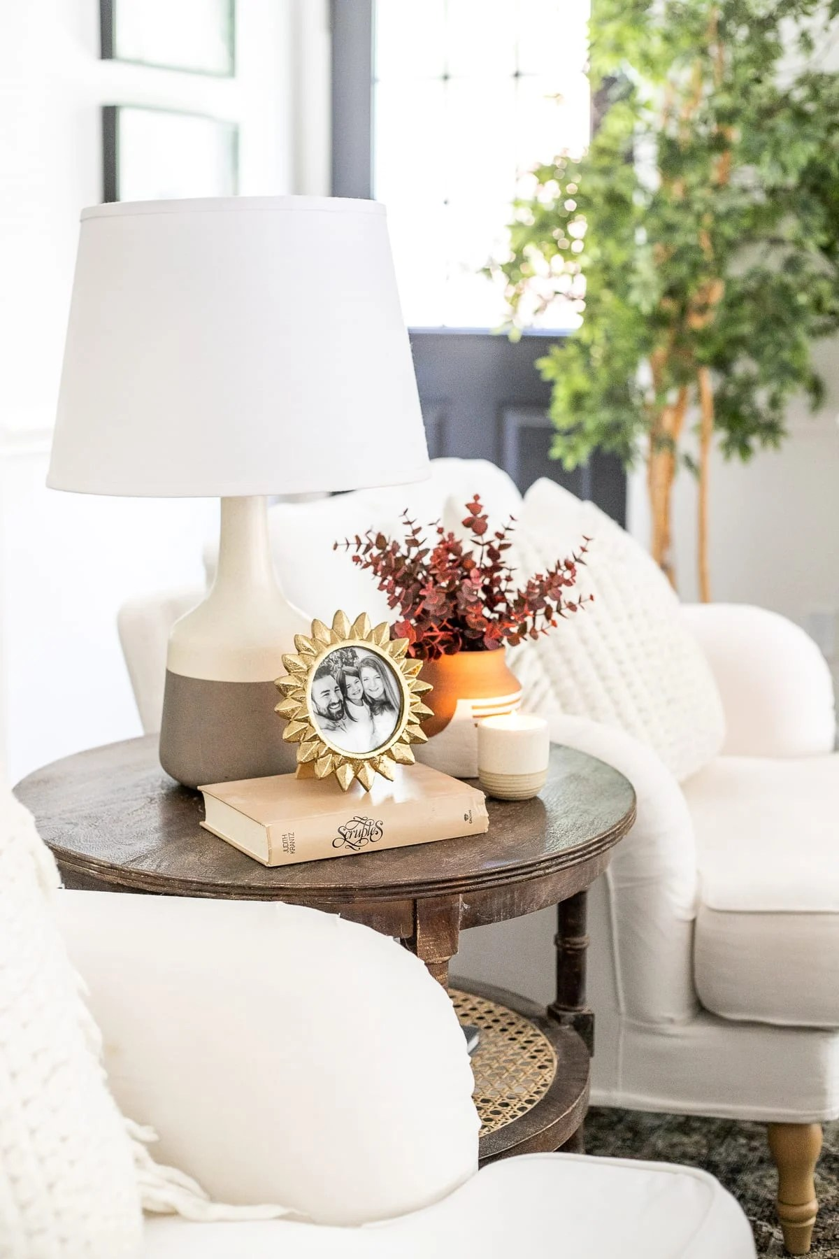 living room end table with fall stems in vase
