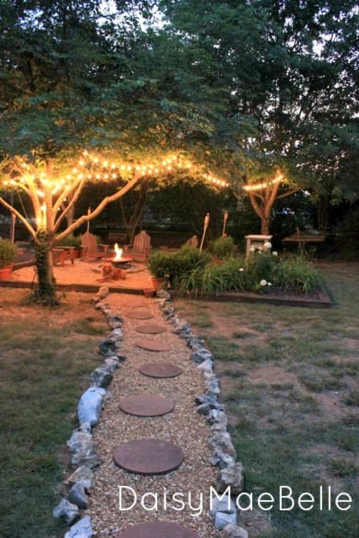 fire pit with string lights in trees