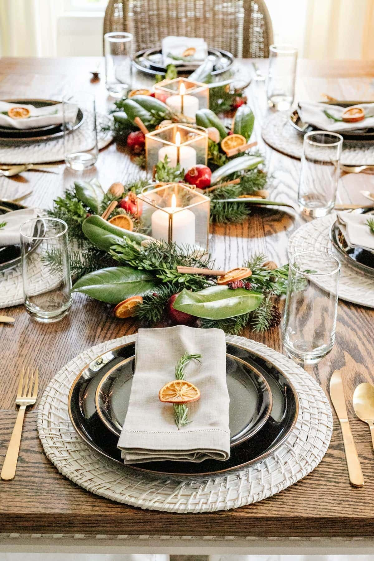 Christmas table centerpiece with fresh leaves and dried citrus