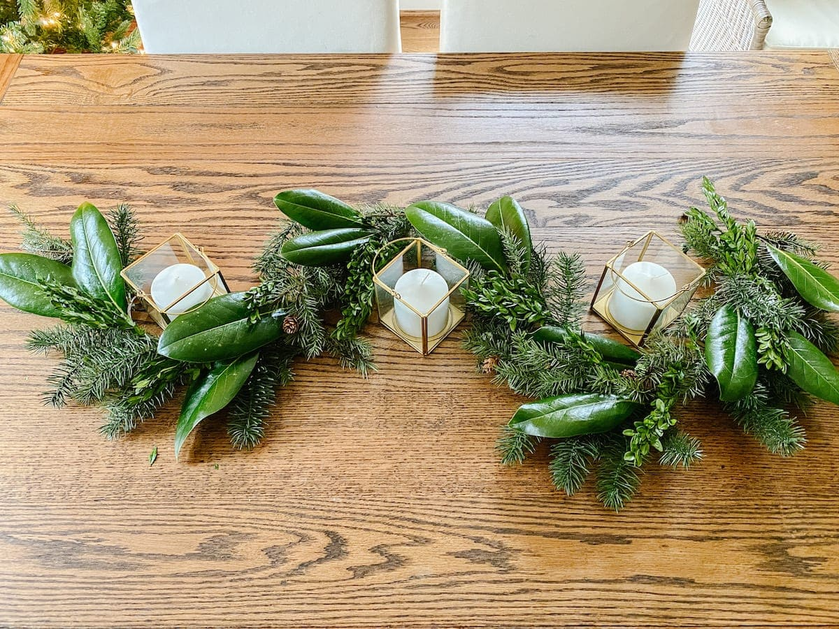 How to make cheap Christmas garland look high-end with magnolia leaves and boxwood stems