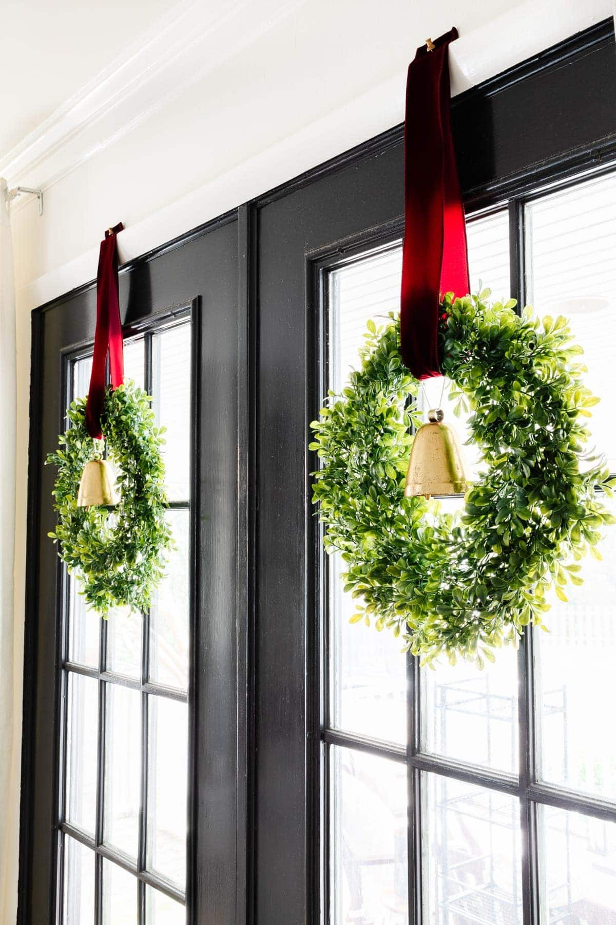 Hanging wreaths on windows
