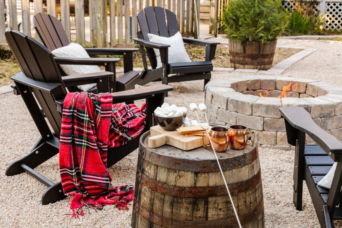 Stone DIY fire pit with pea gravel and adirondack chairs