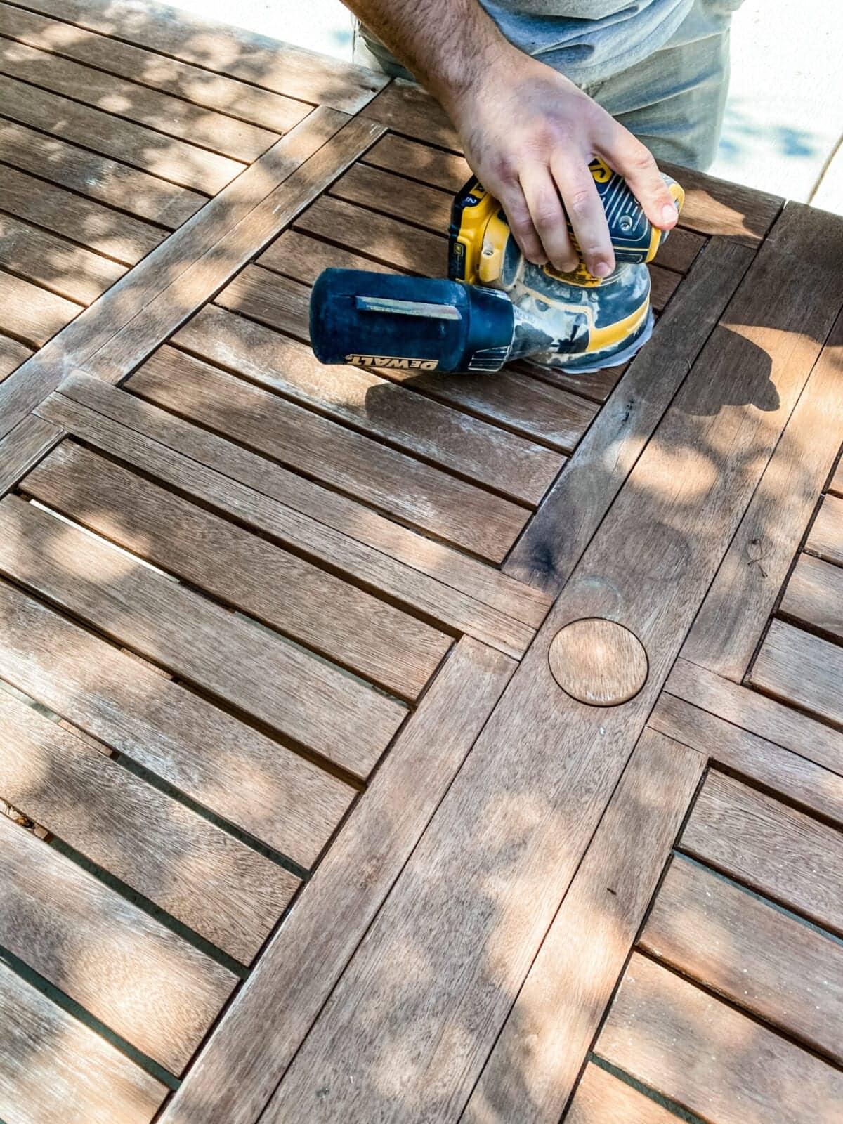 sanding an outdoor table