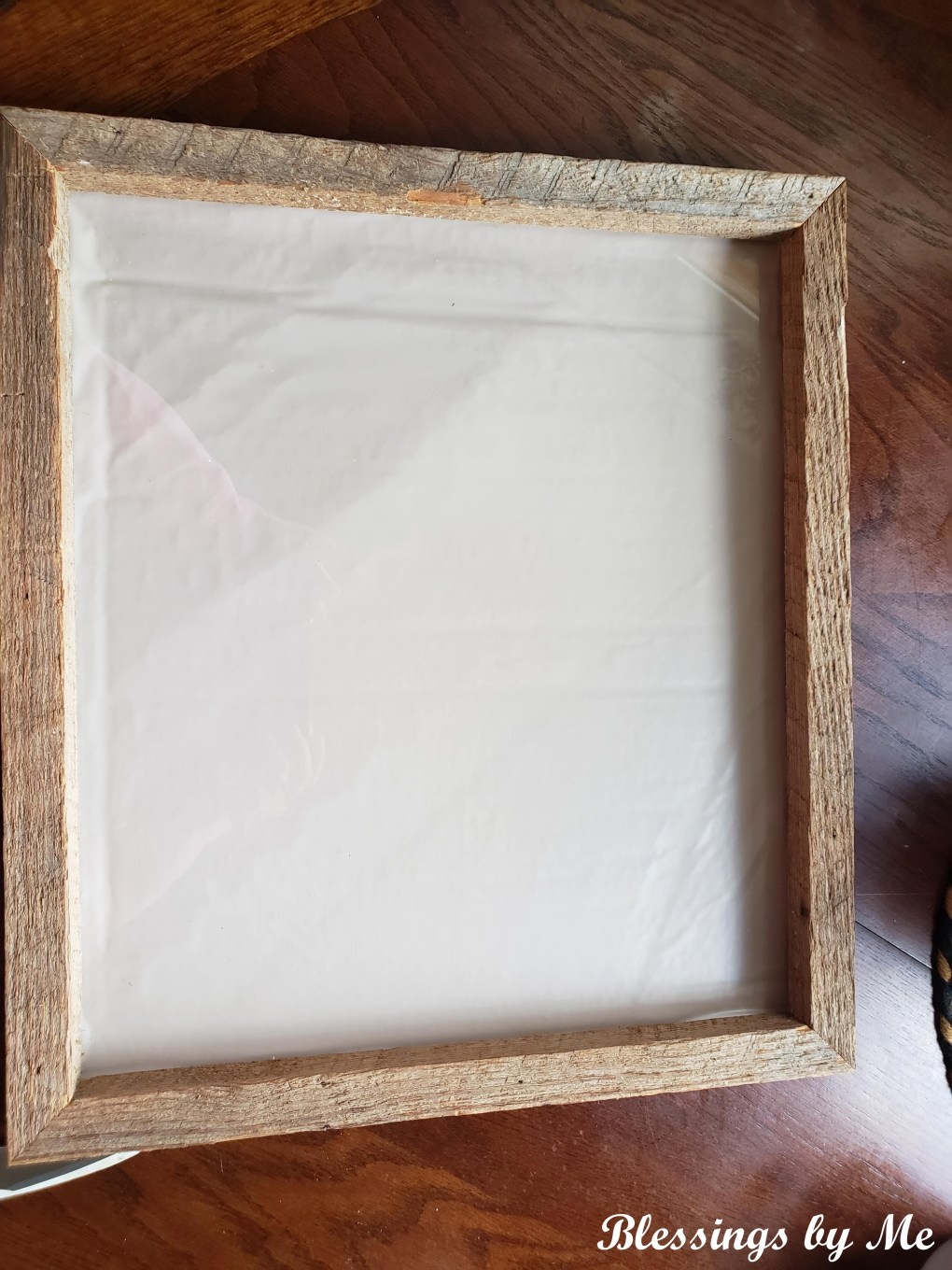 front view of farmhouse wreath frame