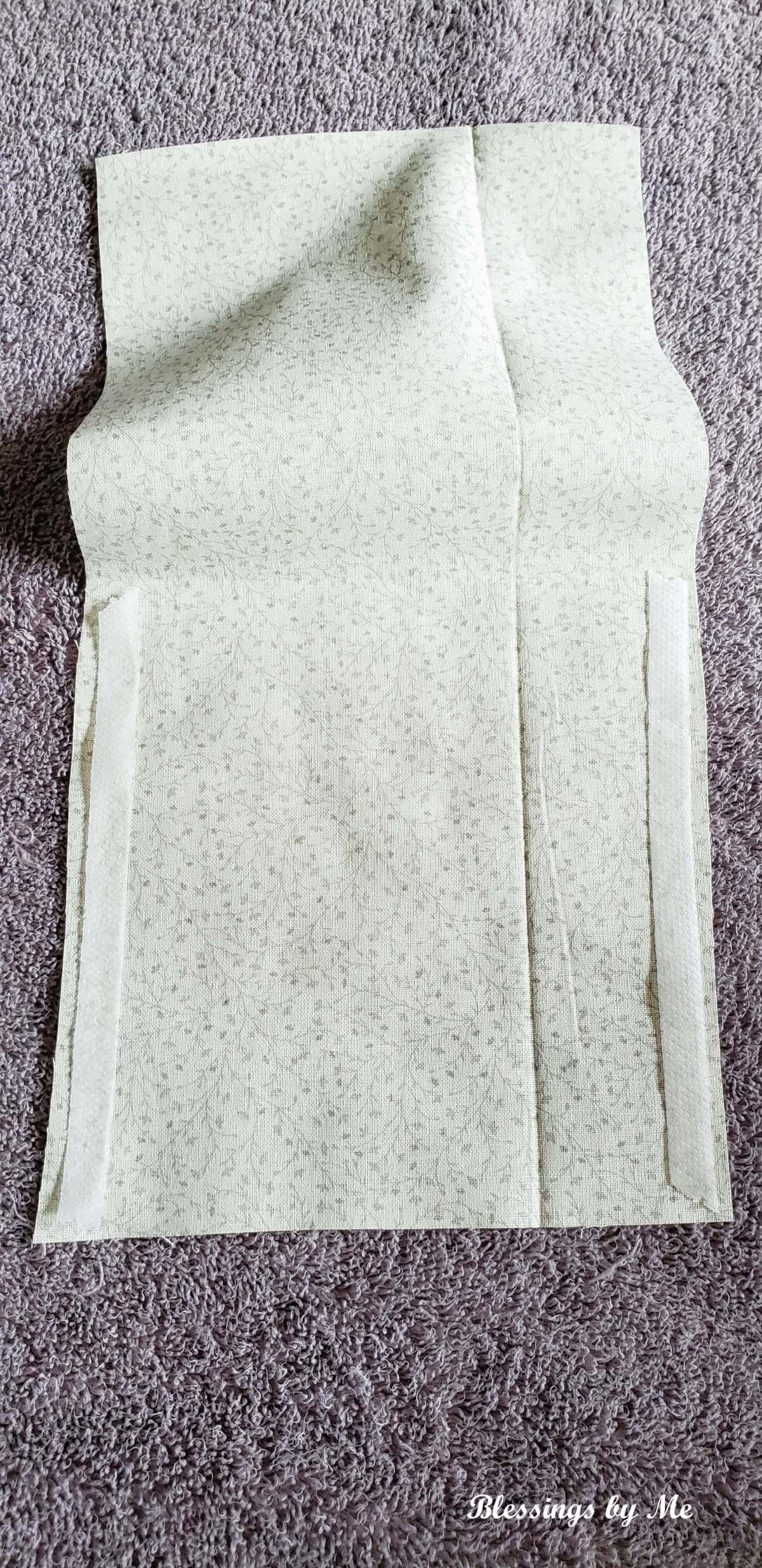 DIY No Sew Lavender Scented Drawer Sachet step 1: fold fabric in half. Place hem tap on both sides.