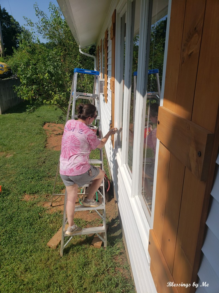 Painting the windows to bring out the shutters