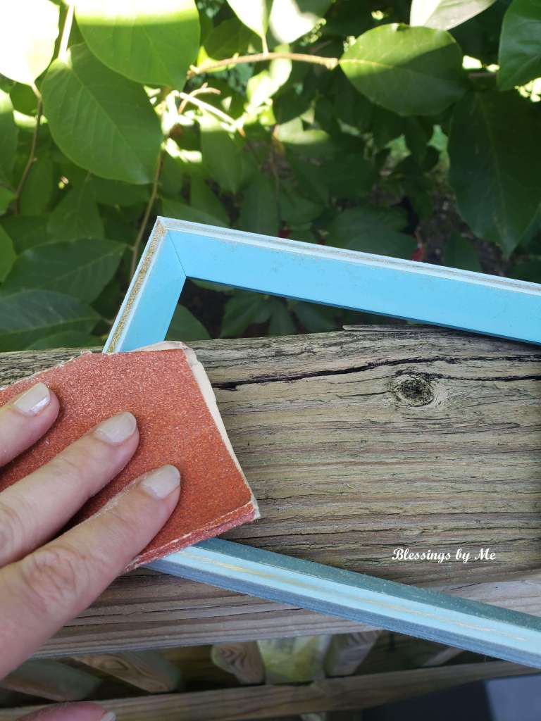 Sand the picture frame.