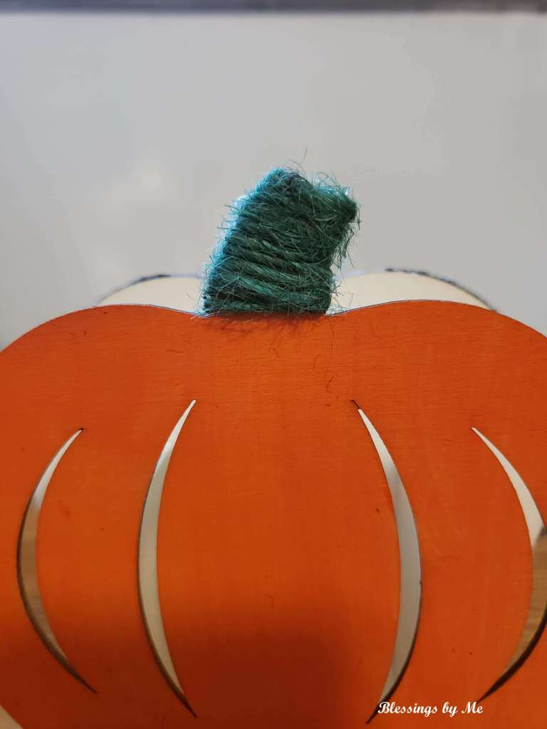 Wrap jute string around the pumpkin stem