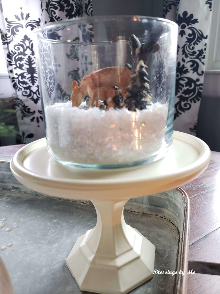 Repurposed candle jar turned into a winter scene