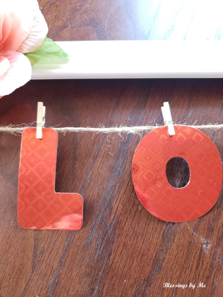 Hang letters on with clothespins