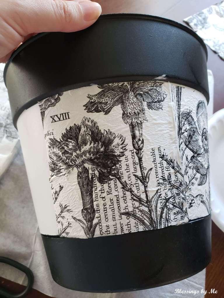 Use Mod Podge to put the napkin on the flower pot