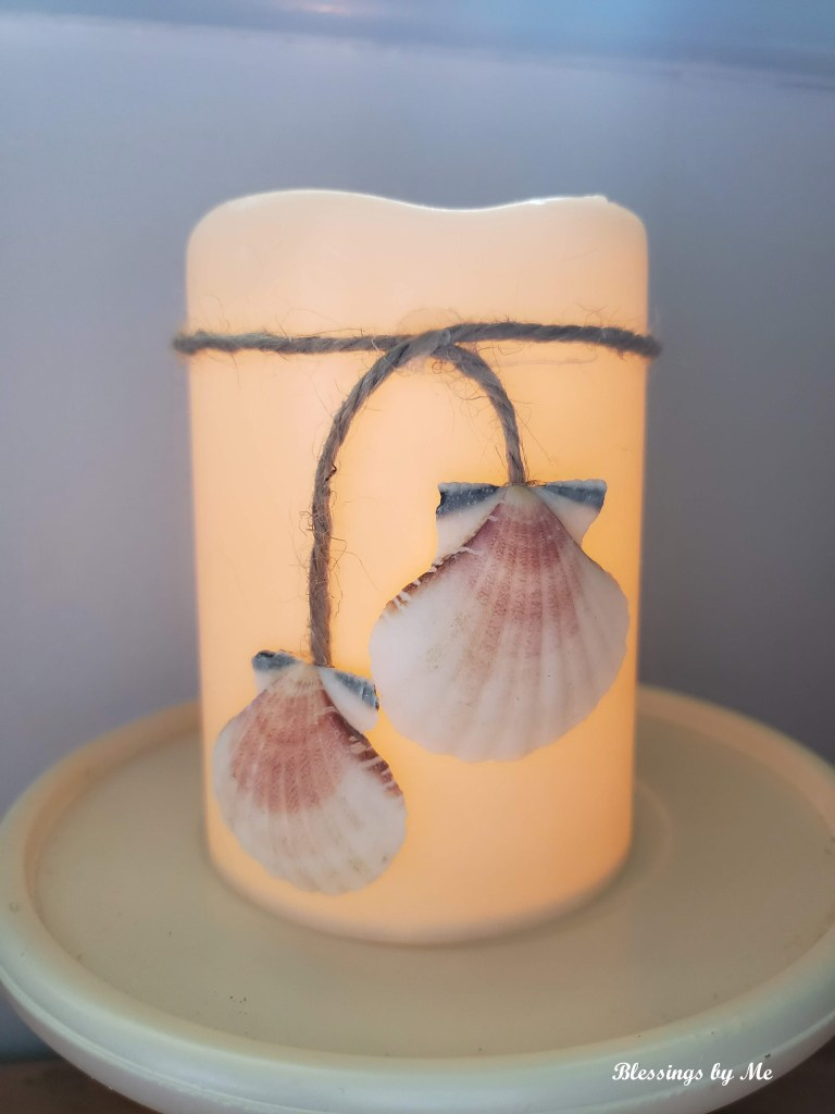 completed seashell candle