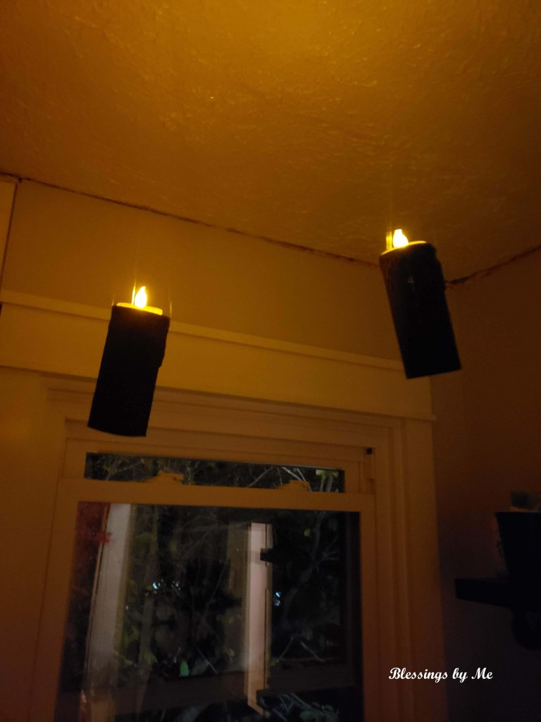 lit candles hanging from ceiling