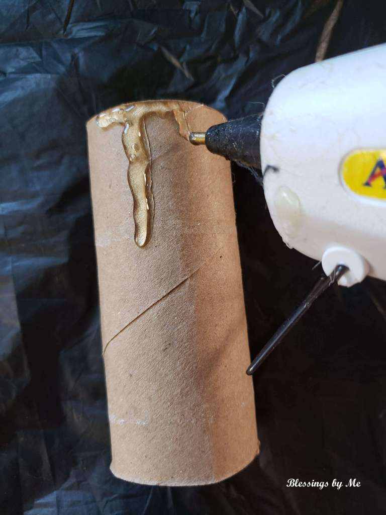 step 1 - hot glue around the top of the toilet paper roll