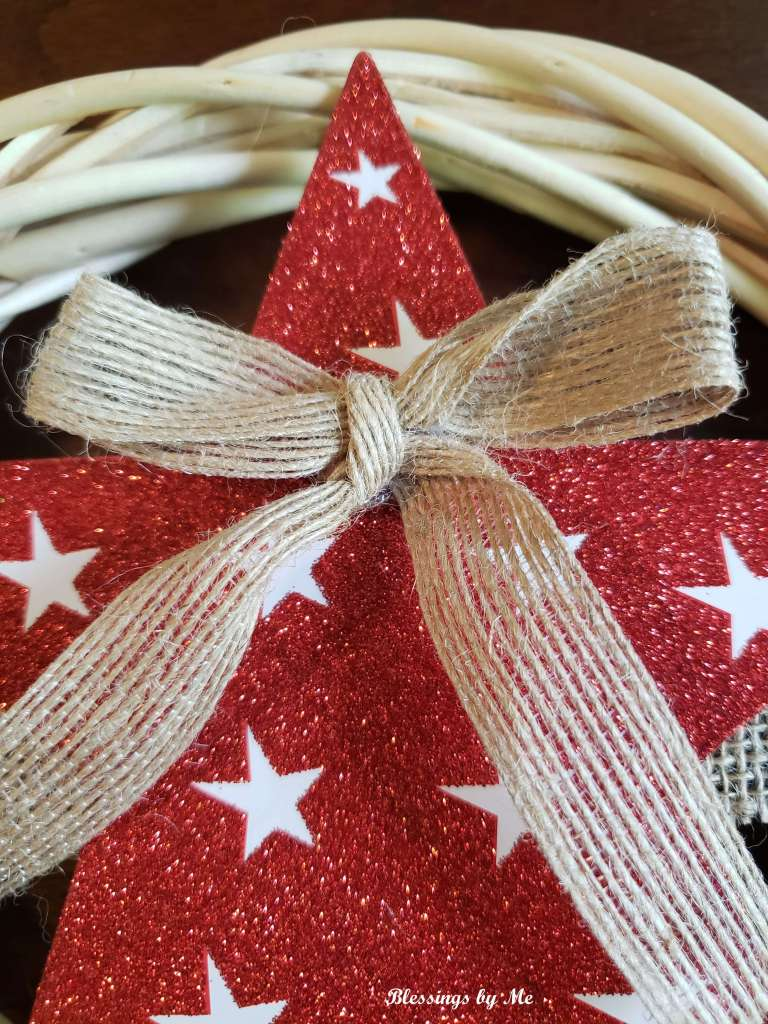 glue the burlap bow to the star