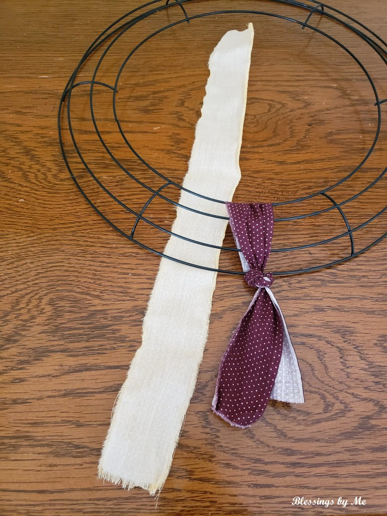 lay the fabric strip under the wreath wrong side up