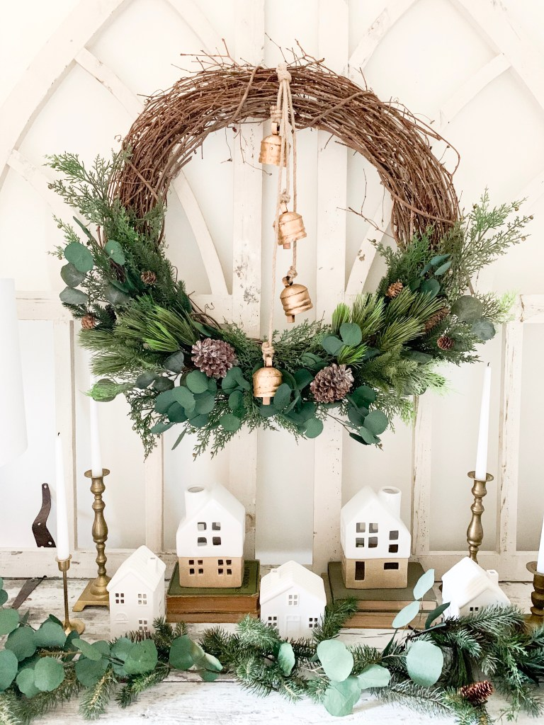 Christmas wreath hanging on arched windows.