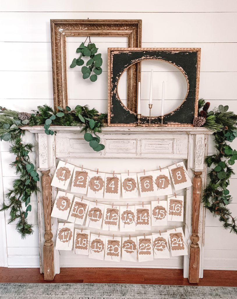 Faux mantel with bags hanging for advent calendar on bottom.