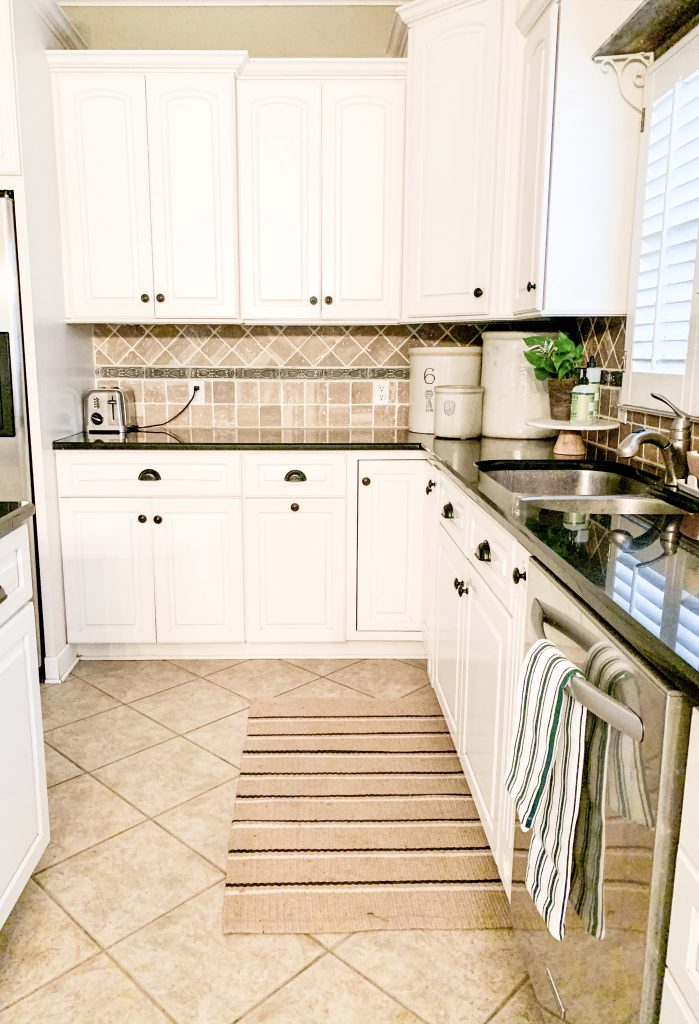 white kitchen with stone backsplash