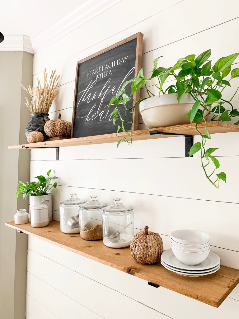 wood shelves in the kitchen with fall decor