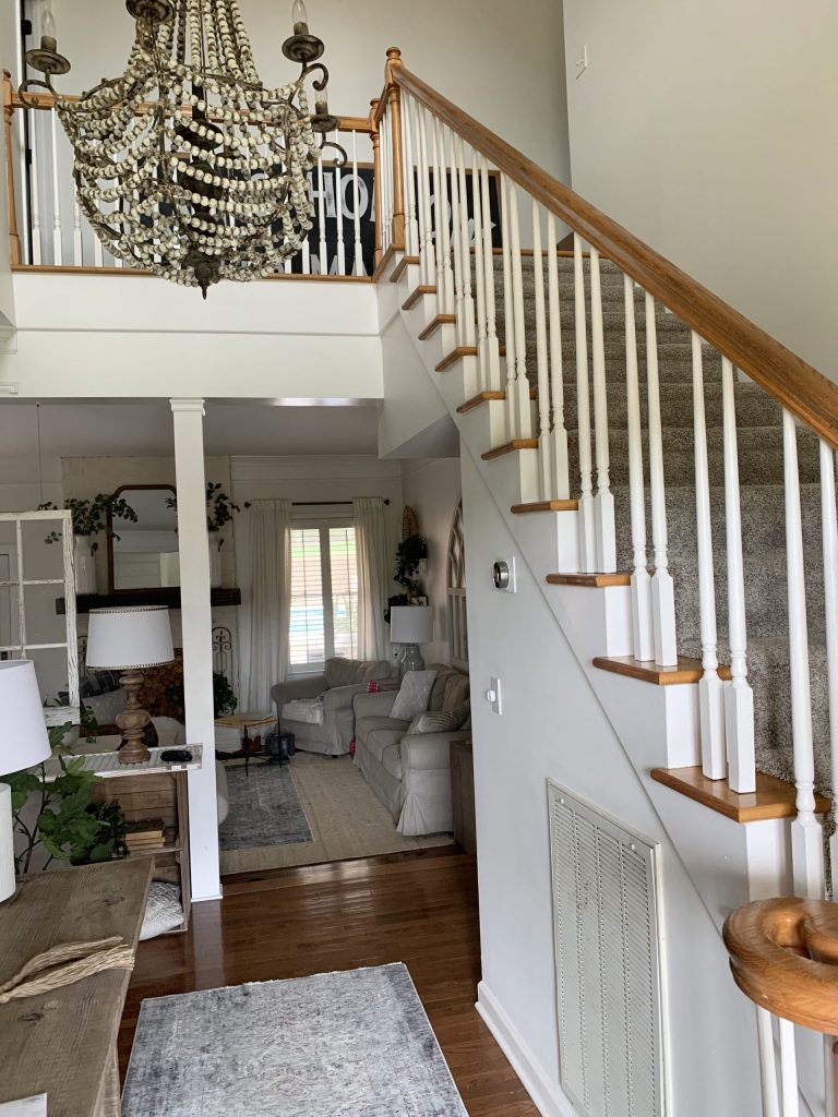 wood staircase with white spindles