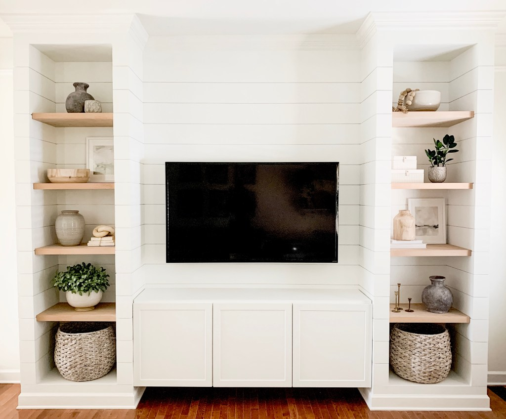 media built in reveal with decor on shelves