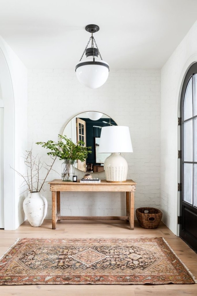white brick entryway with wood table for inspiration photo