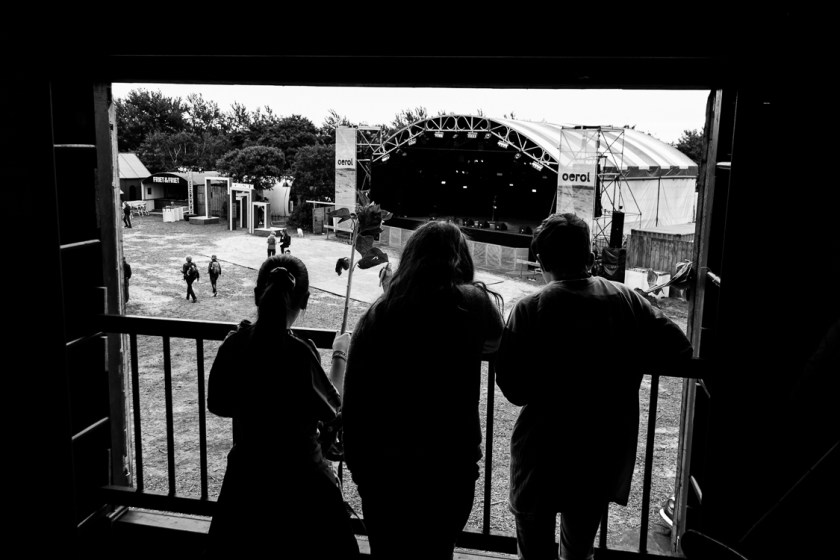 Three kids staring at the festival ground from above.