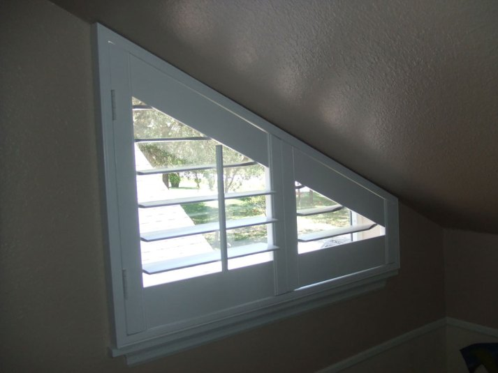 Triangle window with shutters