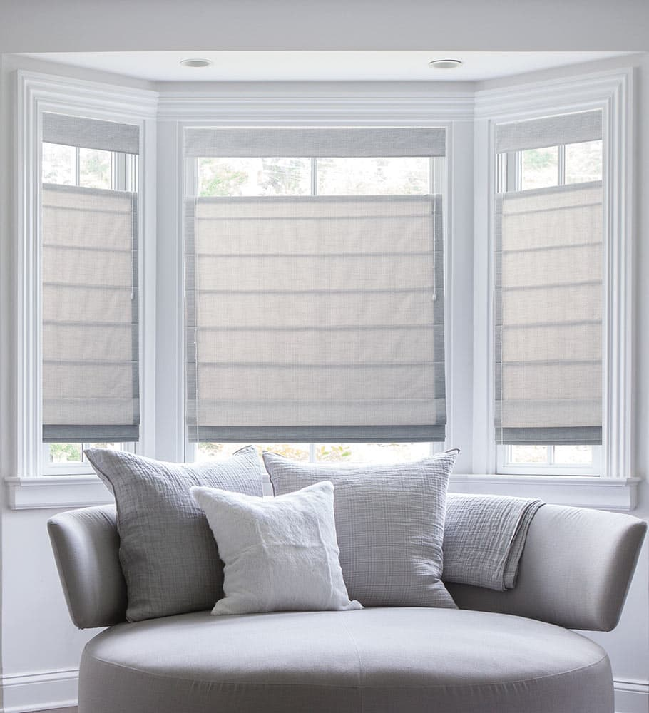 the ultimate guide to blinds for bay windows the finishing touch rh blinds com Living Room Cellular Shades Large Living Room Window Treatments