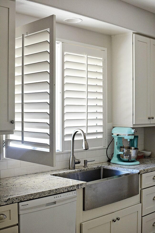 Genial These Shutters Are Custom Made To Slide Side To Side, Allowing Mique To  Clean Behind Them Without Hitting The Kitchen Faucet. The Bright White  Color She ...