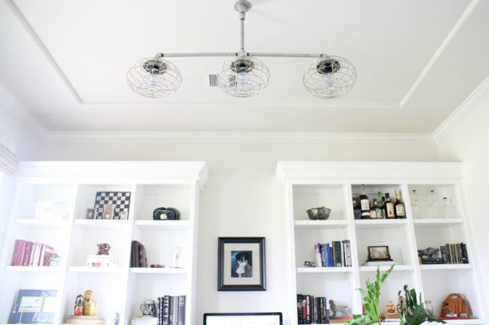 home office light fixture with vintage cages and styled bookcases