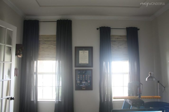 Blinds.com woven wood shades in home office with curtain rods hung at various heights for comparison