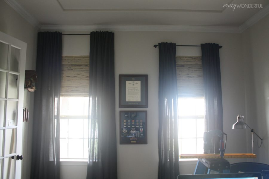 Blinds.com Woven Wood Shades In Home Office With Curtain Rods Hung At  Various Heights