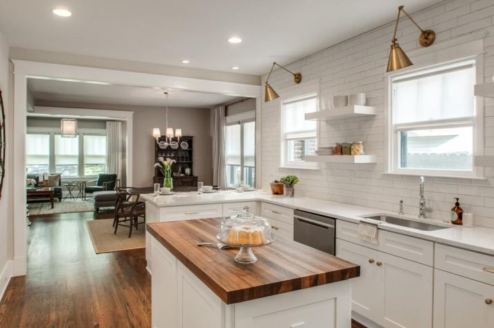White farmhouse kitchen with open floorplan to dining room and living room