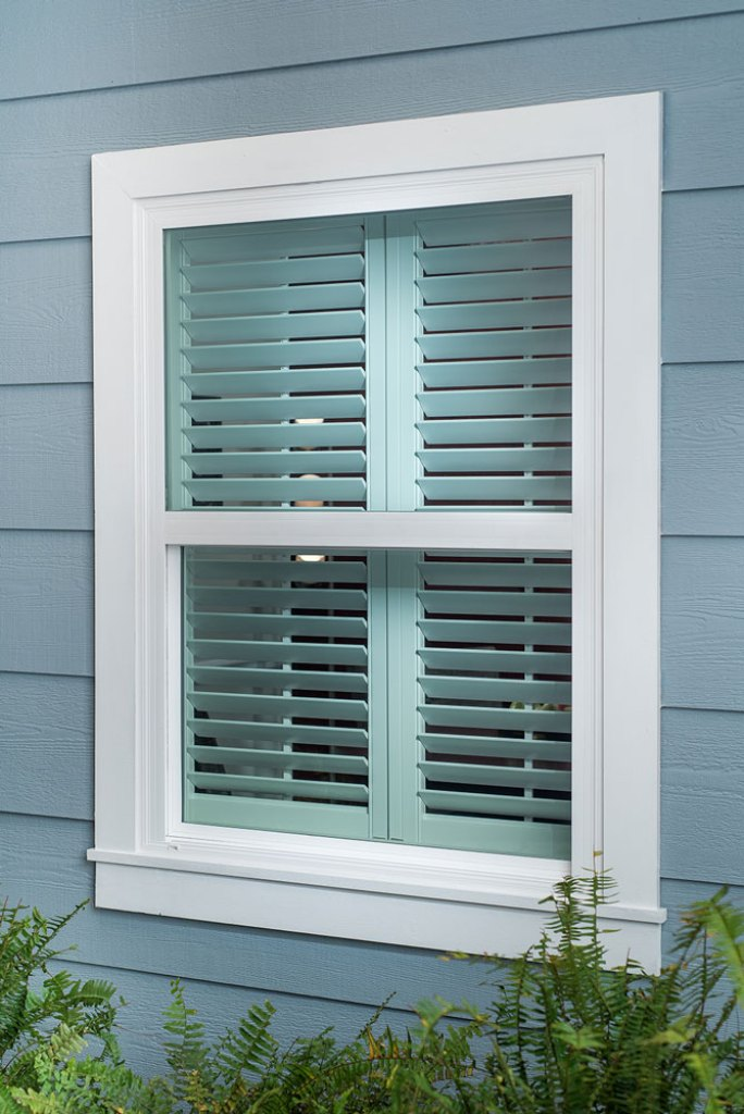 white plantation shutters from outside of home