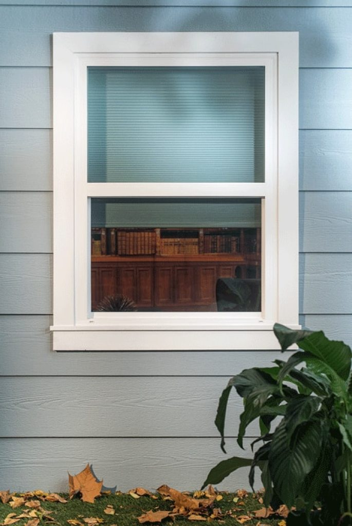 white cellular shades from outside of home