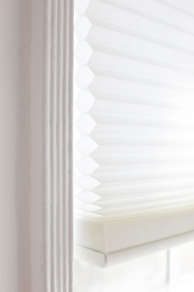 closeup profile shot of modern cellular shades in dining room