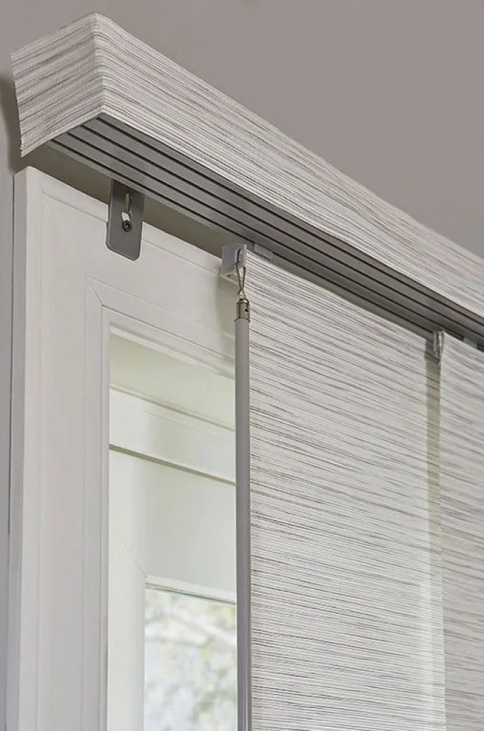 closeup shot of track and fabric wrapped valance for sliding panel track blinds from Blinds.com
