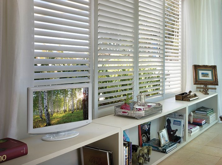 sliding plantation shutter panels over wide window or sliding glass door