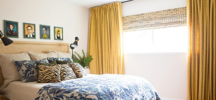 guest bedroom with woven wood shades