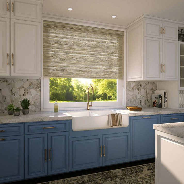 beautiful kitchen with white upper cabinets and lower cabinets and woven grass window shade over the kitchen sink.