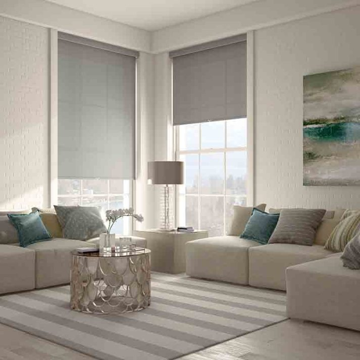 contemporary living room with corner windows covered with grey roller shades with cordless lift and valance